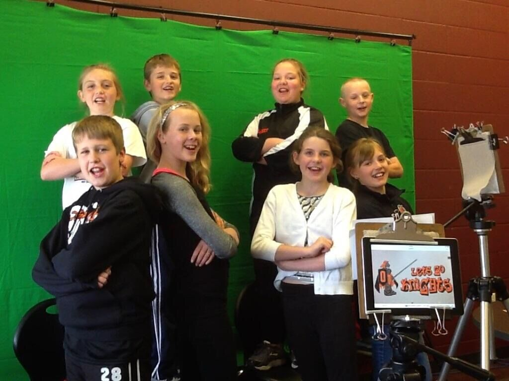 Weekly video announcements made by elementary school school students using  green screen, an ipad,