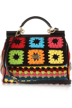 Dolce & Gabbana Crocheted-cotton leather-trimmed tote The designs of iconic Italian duo Dolce & Gabbana are known for their sense of fun, and this playful multicolored crocheted-cotton tote encapsulates the label's exuberant fashion spirit. We love the contrast between the bright fabric and the classic leather and gold-tone metal frame. Carry it with your favorite LBD to let the bright shades pop.