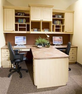 have two office workers in the house home office with two desks