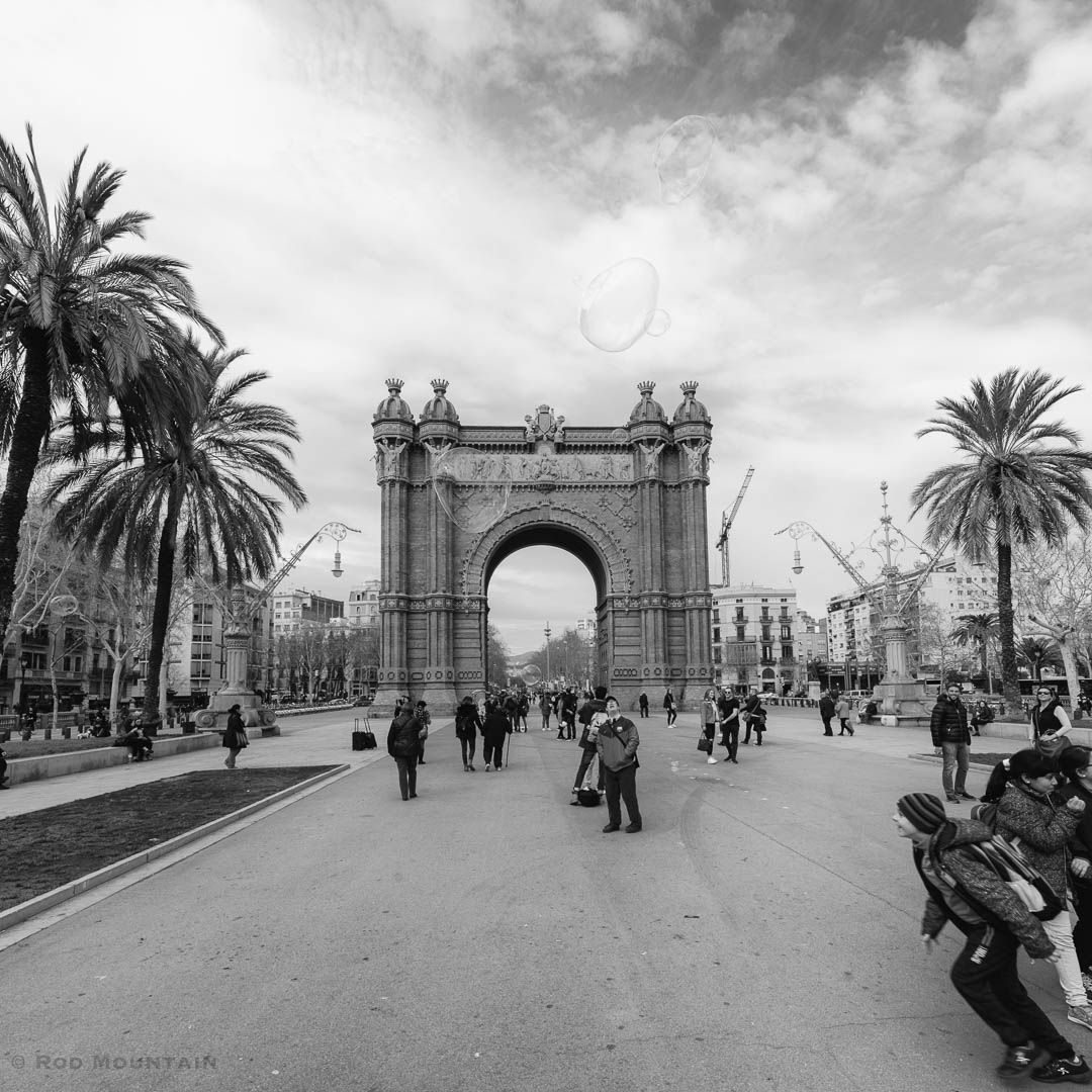 The Street scene near Barcelona's Arc de Triomf. Designed as the main gateway for the 1888 Barcelona World Fair by Architect Josep Vilaseca i Casanovas  Image: © Rod Mountain  #instapassport #earthofficial #places_wow #worldtravelpics #europe_greatshots #Barcelona #photojournalism #streetexploration #bwstyleoftheday #urbanandstreet #streettogether #love_bnw #negroyblanco #architeturelovers #friendsinperson #friendsinstreets #storyofthestreets #superhubs #livefolk #latergram #NikonCA #NikonEurope