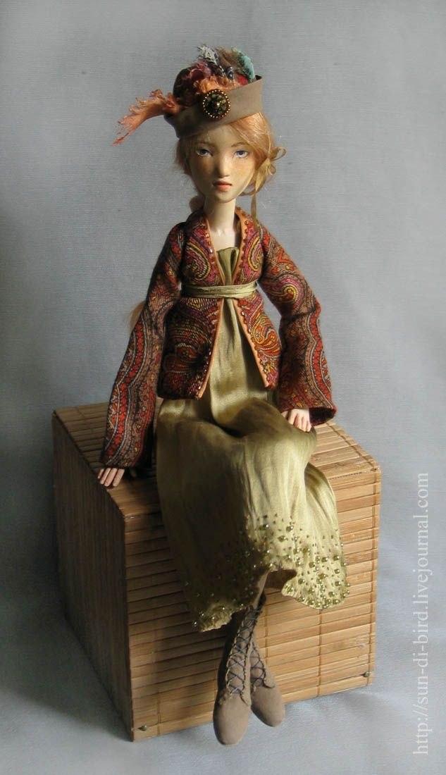 .art doll    Quite lovely! Love the paisley-esk top.