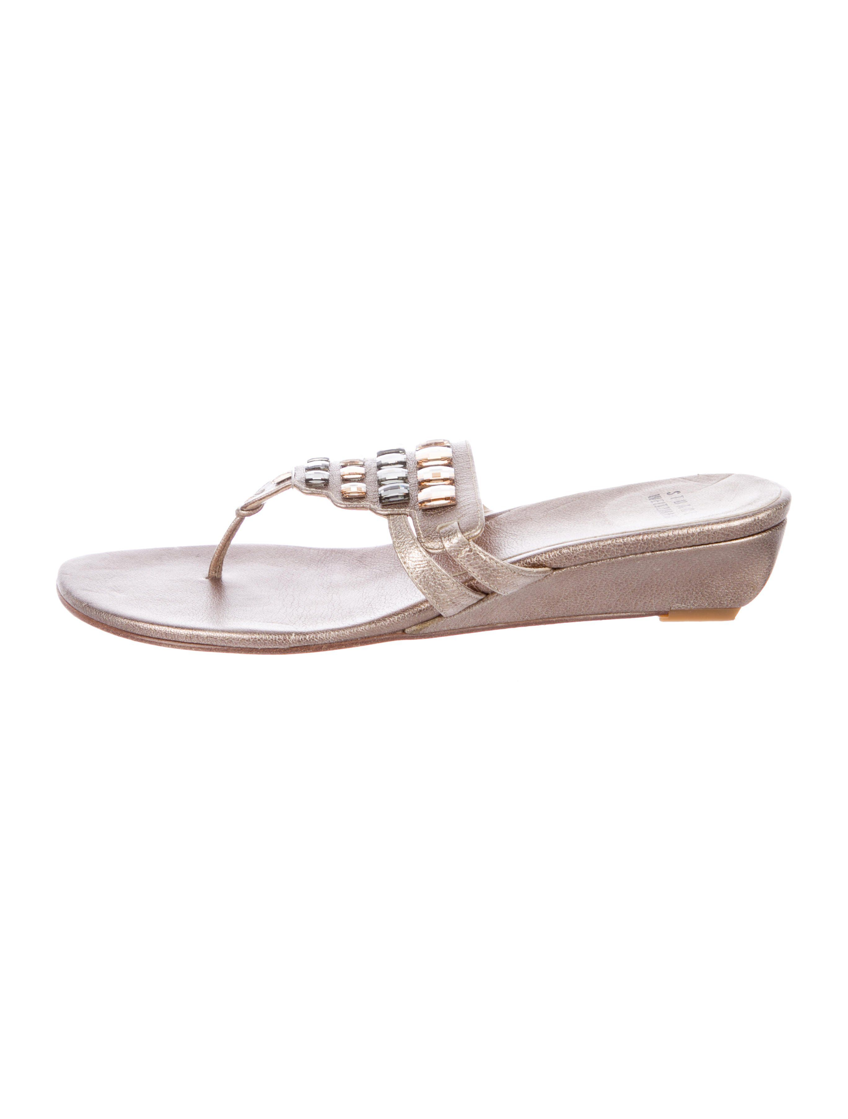 8aadf96ea Metallic leather Stuart Weitzman thong wedge sandals with jewel accents at  uppers