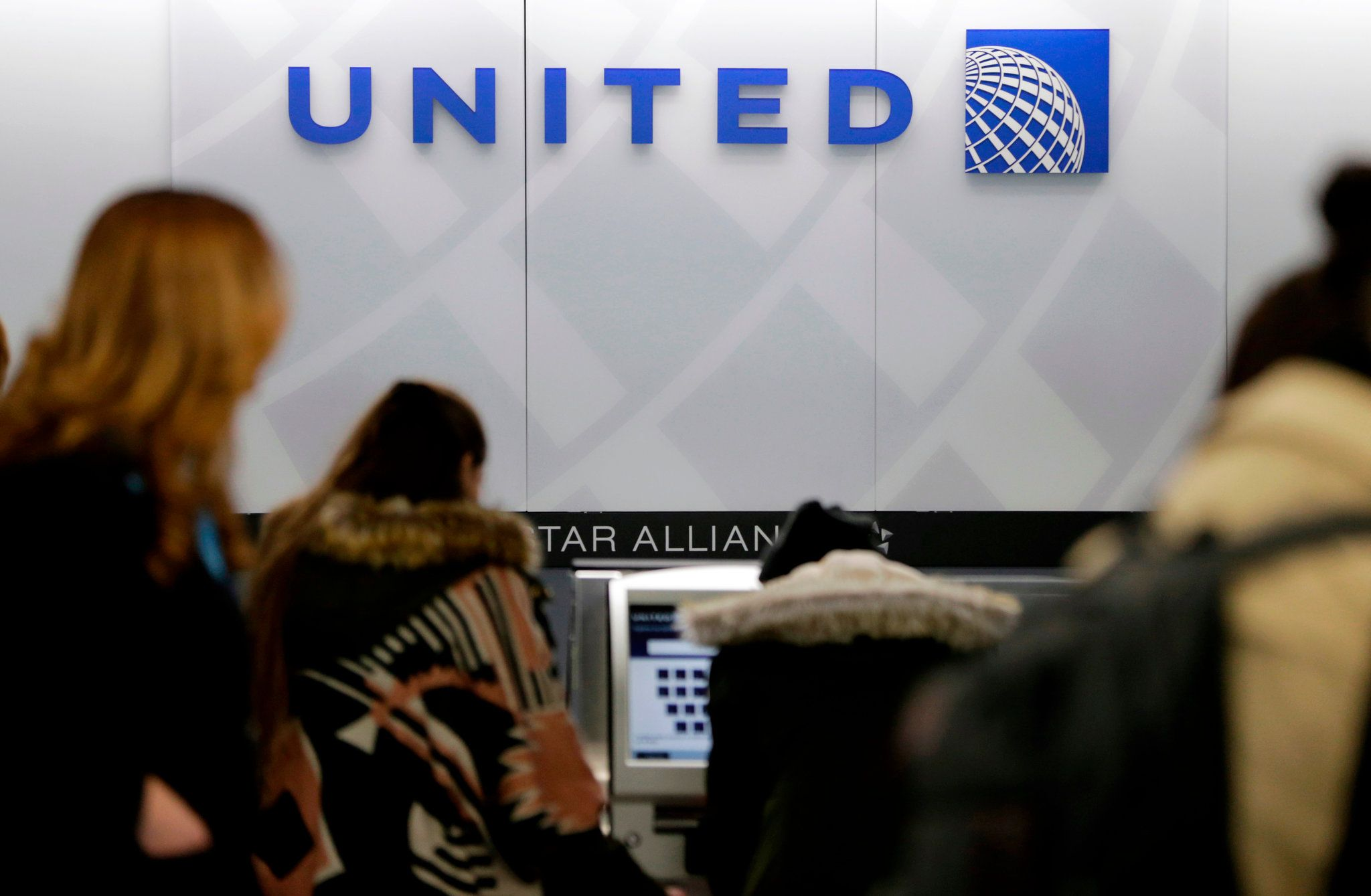 United Airlines Employee Charged With Using Racial Slurs