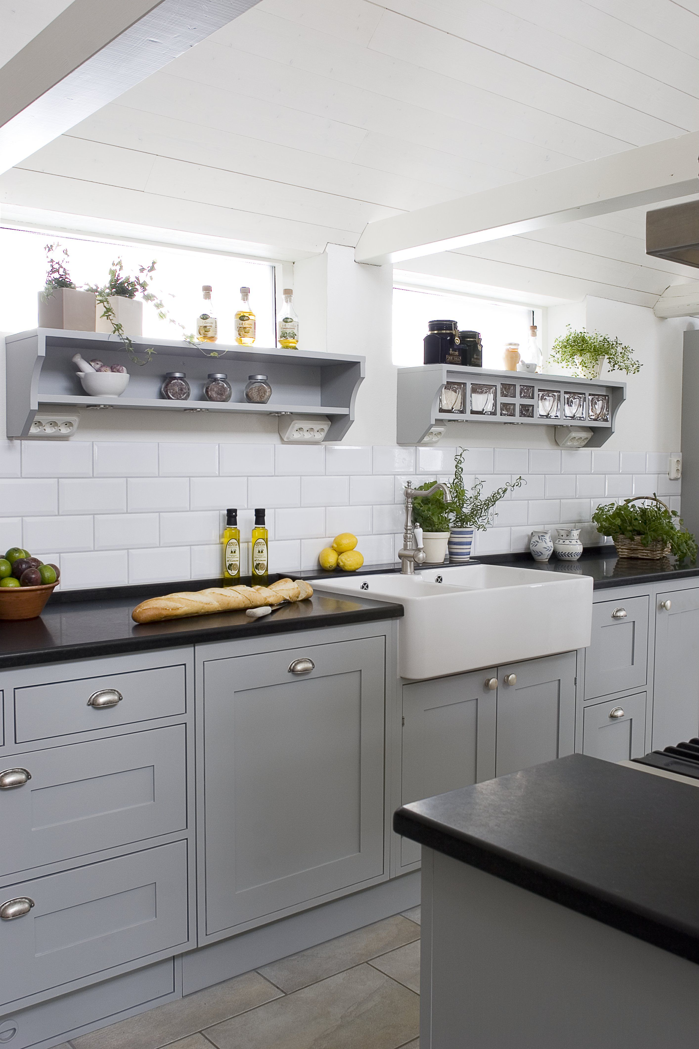 Swedish hand painted kitchen in grey with white tiles, glass jars ...
