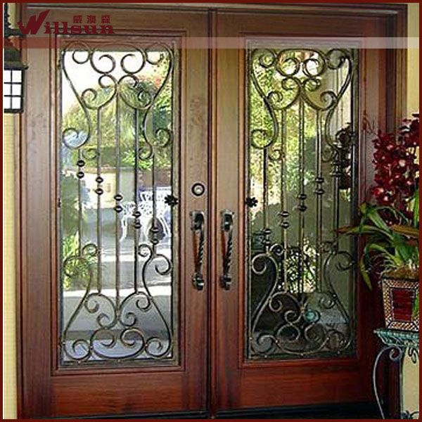 Source double door wood wrought iron entry door on m for Modelos de puertas principales