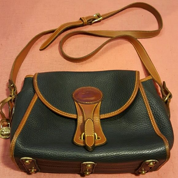"""DOONEY & BOURKE CROSSBODY Gently used , excellent condition, Dark Blue color Pebbled soft leather Dooney & Bourke  has a small pen ink spot on the inside as seen in pic, small scuff a corners not noticeable long strap perfect condition,  has a inside zip pocket and 2 slip pockets ,this  a gorgeous crossbody bag. Measures 10.5""""X 7.5"""" Dooney & Bourke Bags Crossbody Bags"""