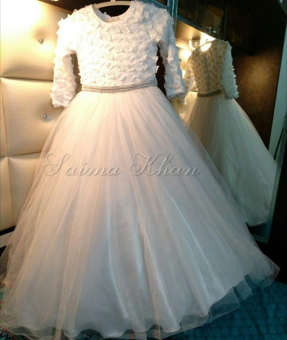 A white ball gown flower girl dress with full sleeves and