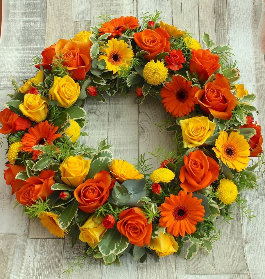Bright wreath with vivid yellow and orange gerbera yellow and stemsations is a florist based in rugby providing beautiful flowers for weddings and funerals and other special occasions izmirmasajfo