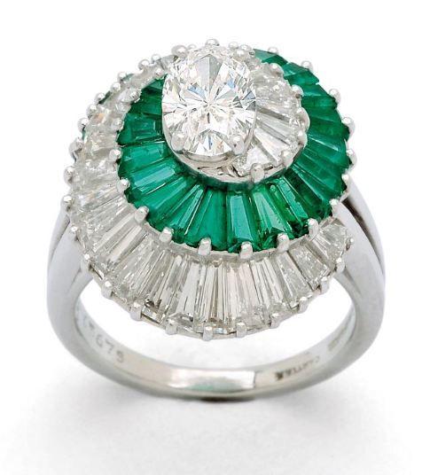 LOT 266 - A Diamond and Emerald Ring, Cartier, circa 1980