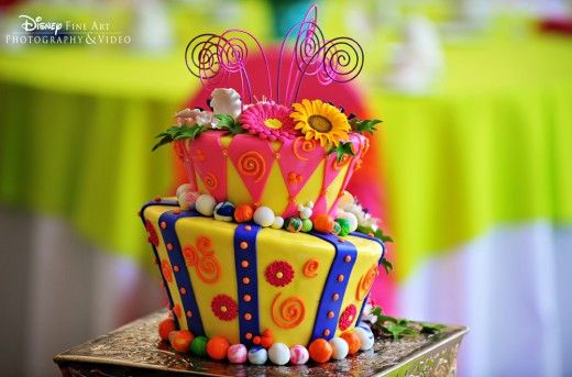 Two tier Mad Hatter style wedding cake with gerber daisy floral ...