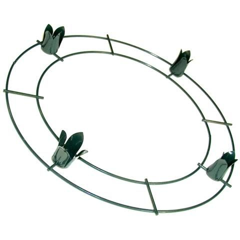 Double rail wreath ring with four candle holders welded onto the form. Can be used with fresh or artificial greenery.
