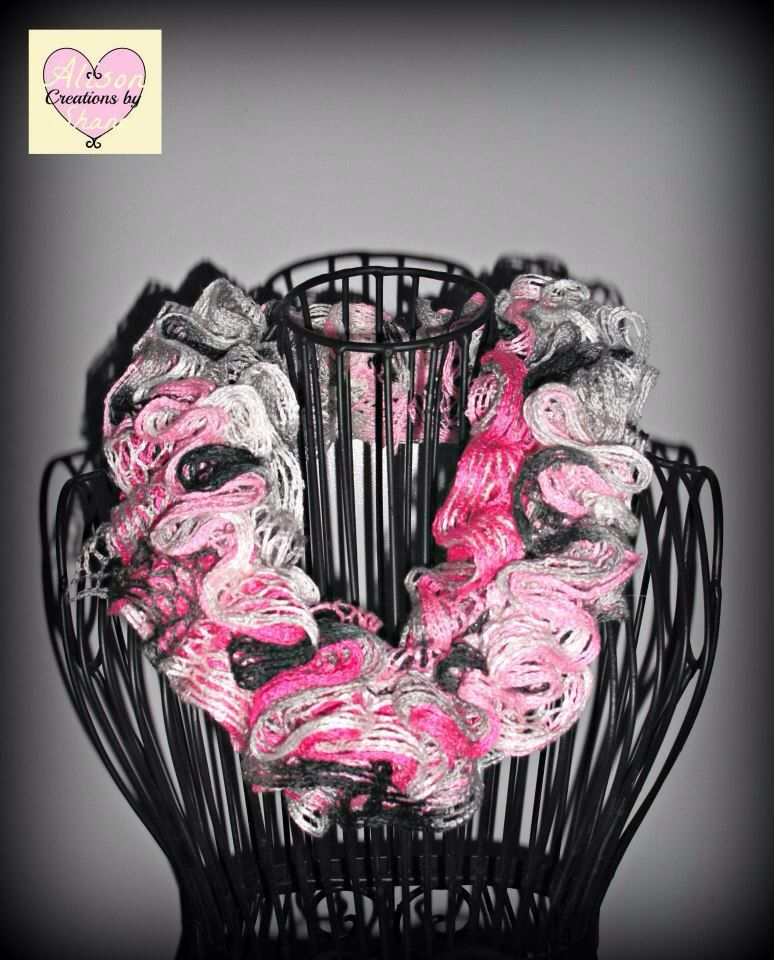 Breast cancer awareness knit infinity scarf. All profits are donated to the breast cancer research foundation. Www.facebook.com/creationsbyalisonshane