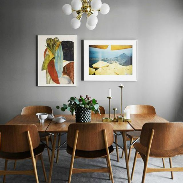 Dining Room Idea With Colorful Framed Pictures Large Wood Table And Grey Walls Fba Words Used To Describe This Home Cozy Co