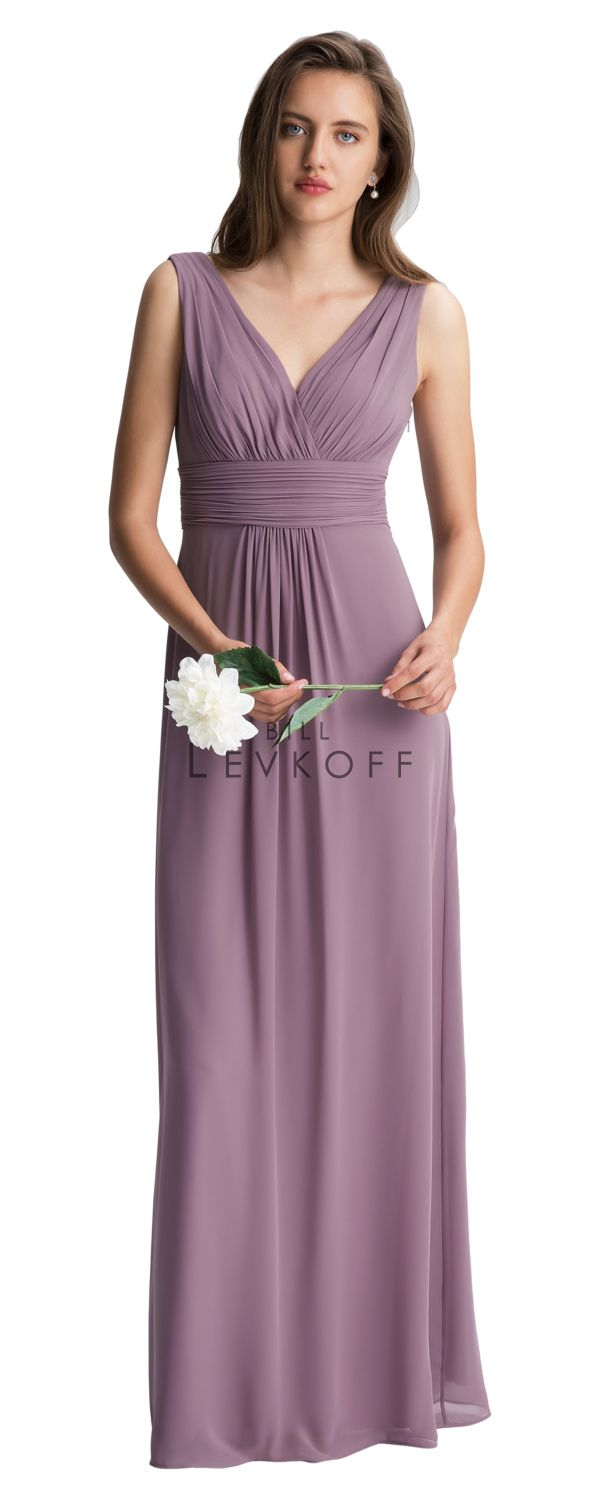 a7c41bb860eec Chiffon surplice sleeveless gown with V front and back. Ruched bodice and  cummerbund. Skirt is adorned with front and back center pleats.