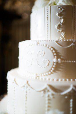 Classic white wedding cake with a monogram (Photo by Eli Turner)