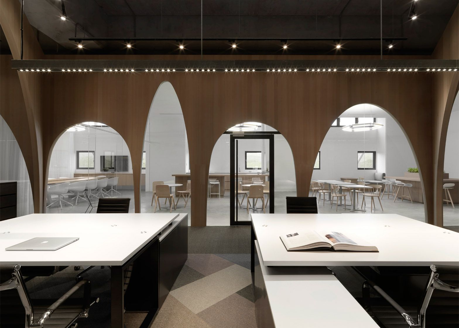 JC Architecture adds wooden arches to H&M's Taiwan office