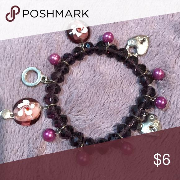 Purple bracelet. Fun purple bracelet. Never worn! Elastic band, slip on bracelet! Jewelry Bracelets