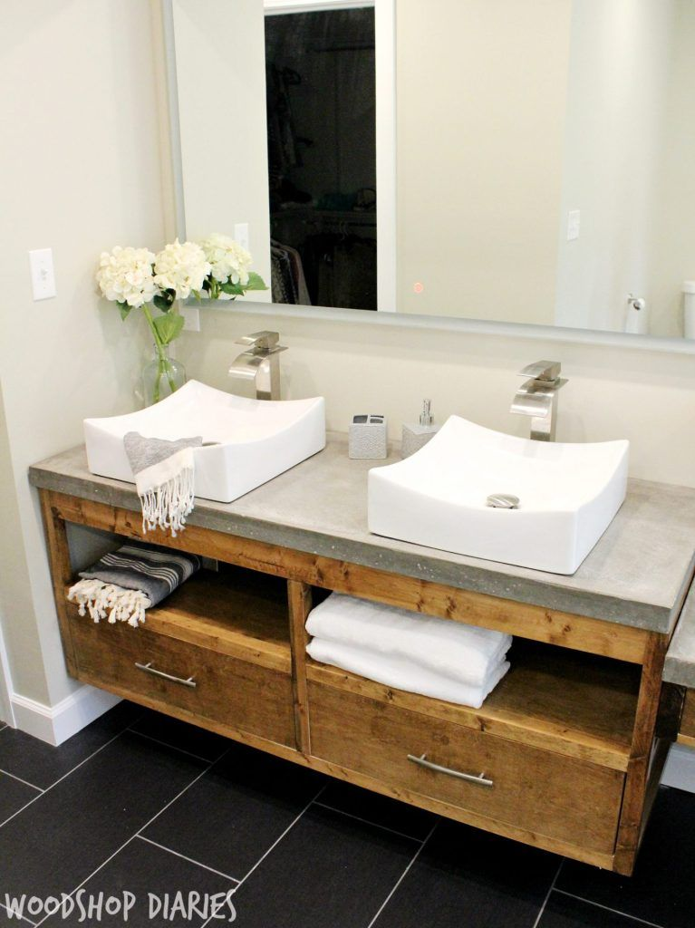 Modern Bathroom With Diy Floating Vanity And Concrete Counter Tops Vessel Sinks And Silver Fin Floating Bathroom Vanities Diy Bathroom Vanity Floating Vanity