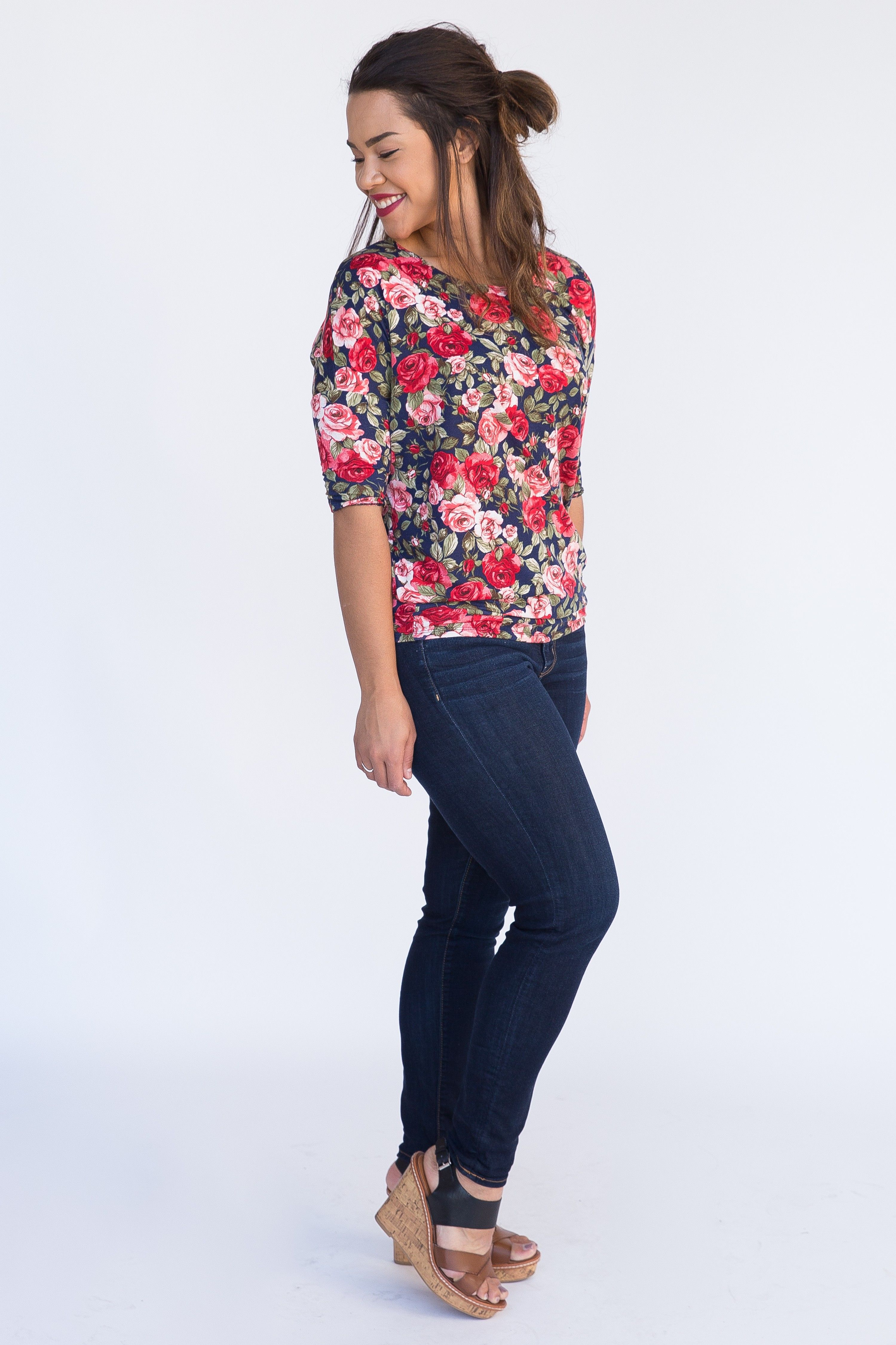 Soft and stretchy top featuring a dolman 3/4 sleeve fitted waist for versatile wear.