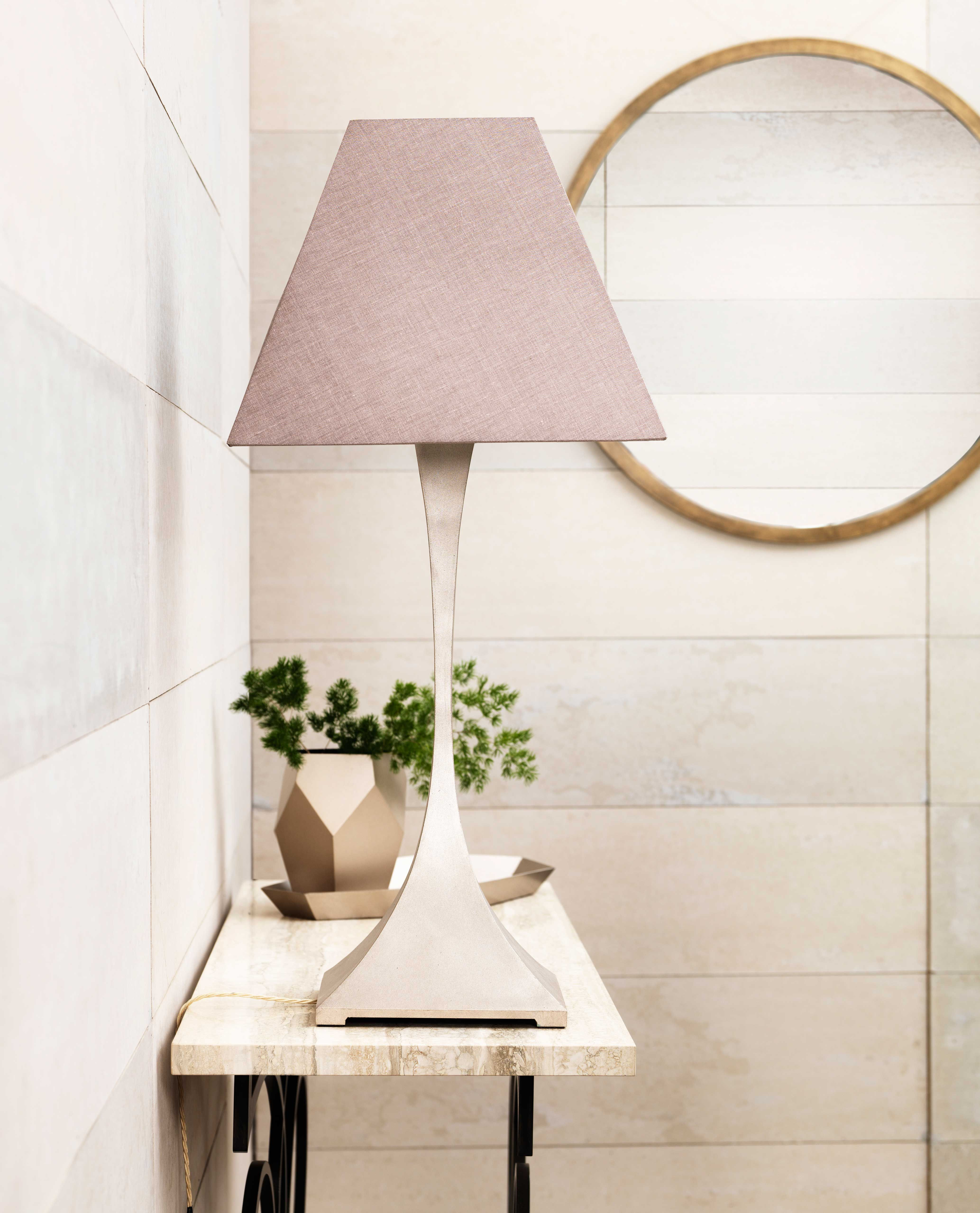 Capricorn table lamp in Pink Silver, Madison round mirror in Antique Bronze and faceted metal vase.