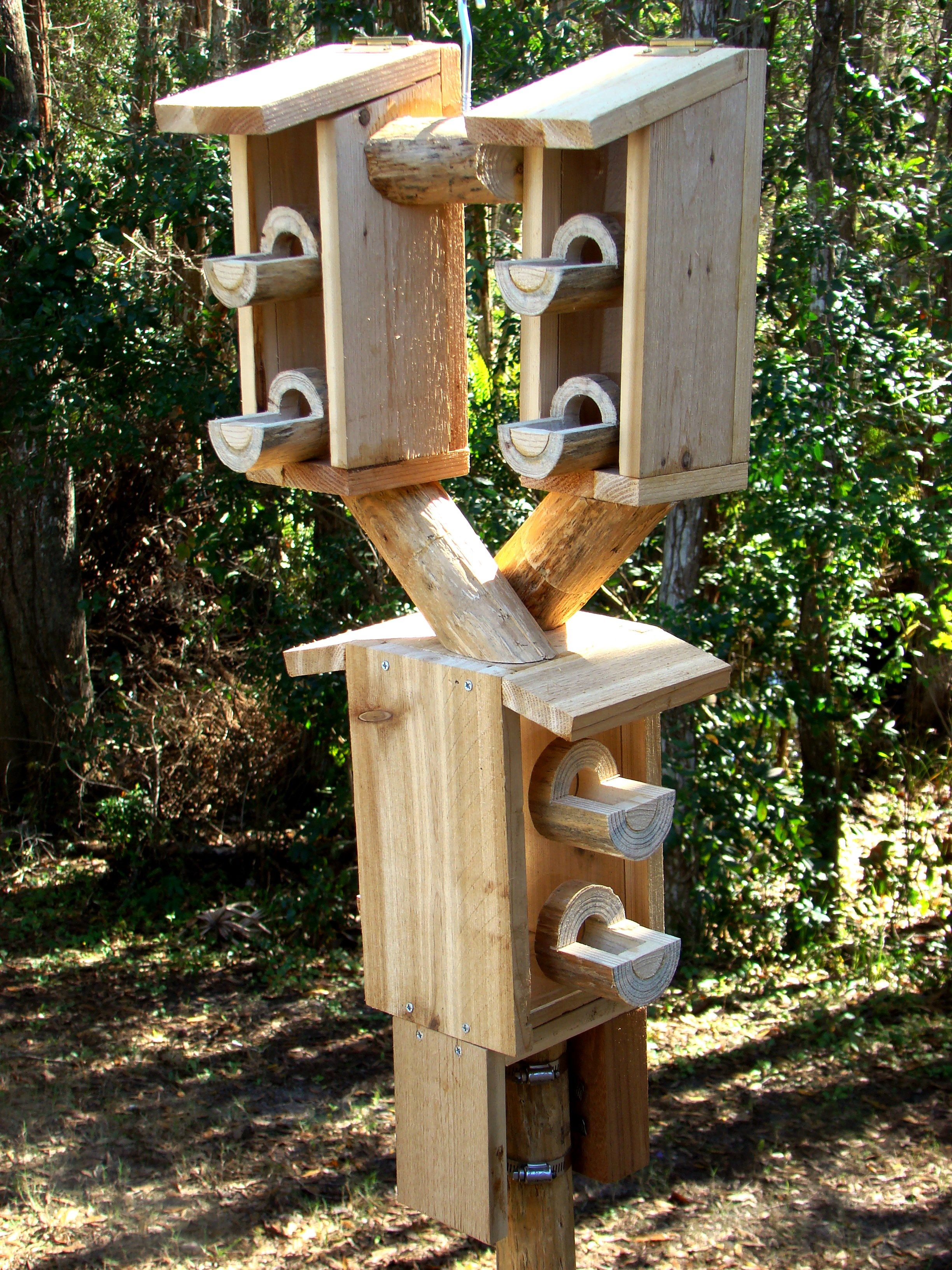 Wooden Bird Feeders On A Pole