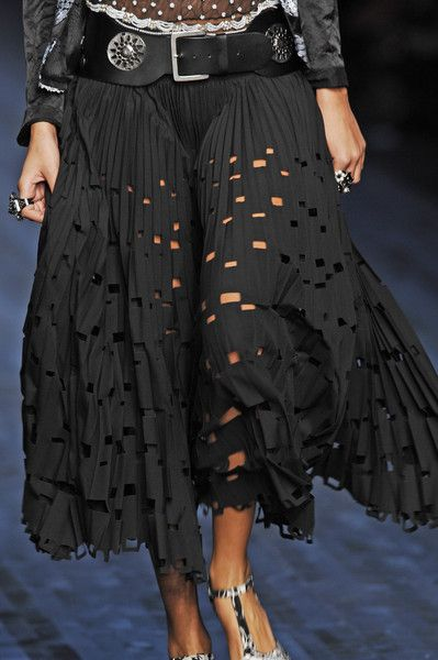 Mariella Burani- it's the BELT and the SKIRT. COOL!