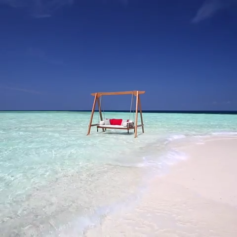 The perfect beach setup for your Maldives honeymoon is located at the resort, Baros Maldives.  Just imagine sitting in this luxurious beach swing with your loved one. Now that's the defintion of tropical paradise.