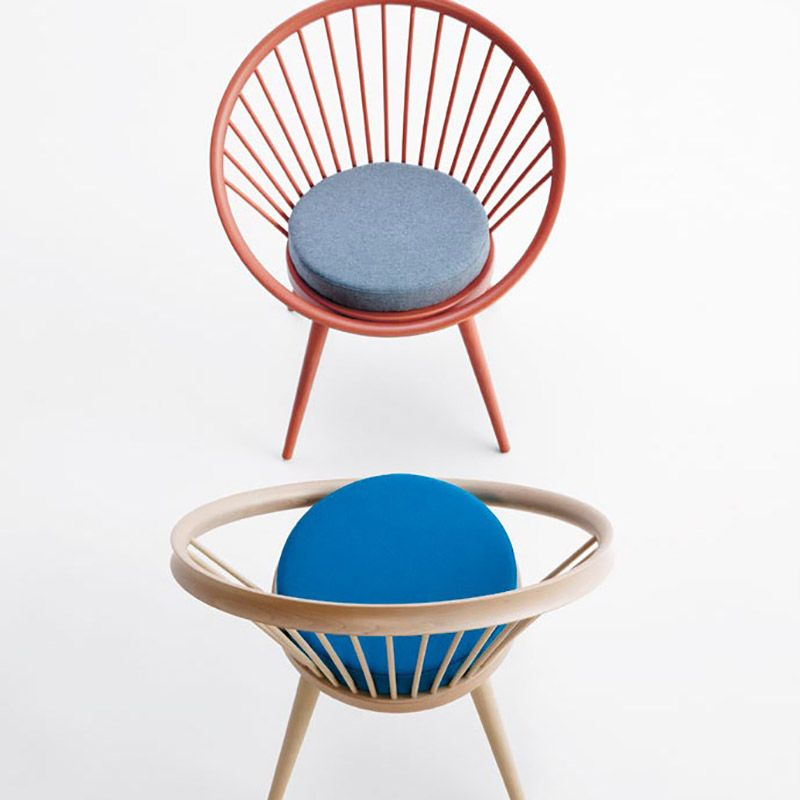 Circular Shaped Chair With A Solid Wood Frame And Upholstered