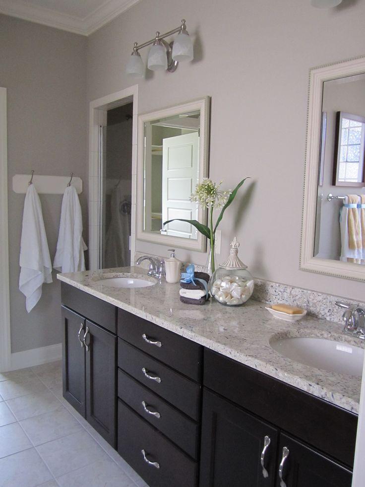 dark cabinets light countertop white door frame and