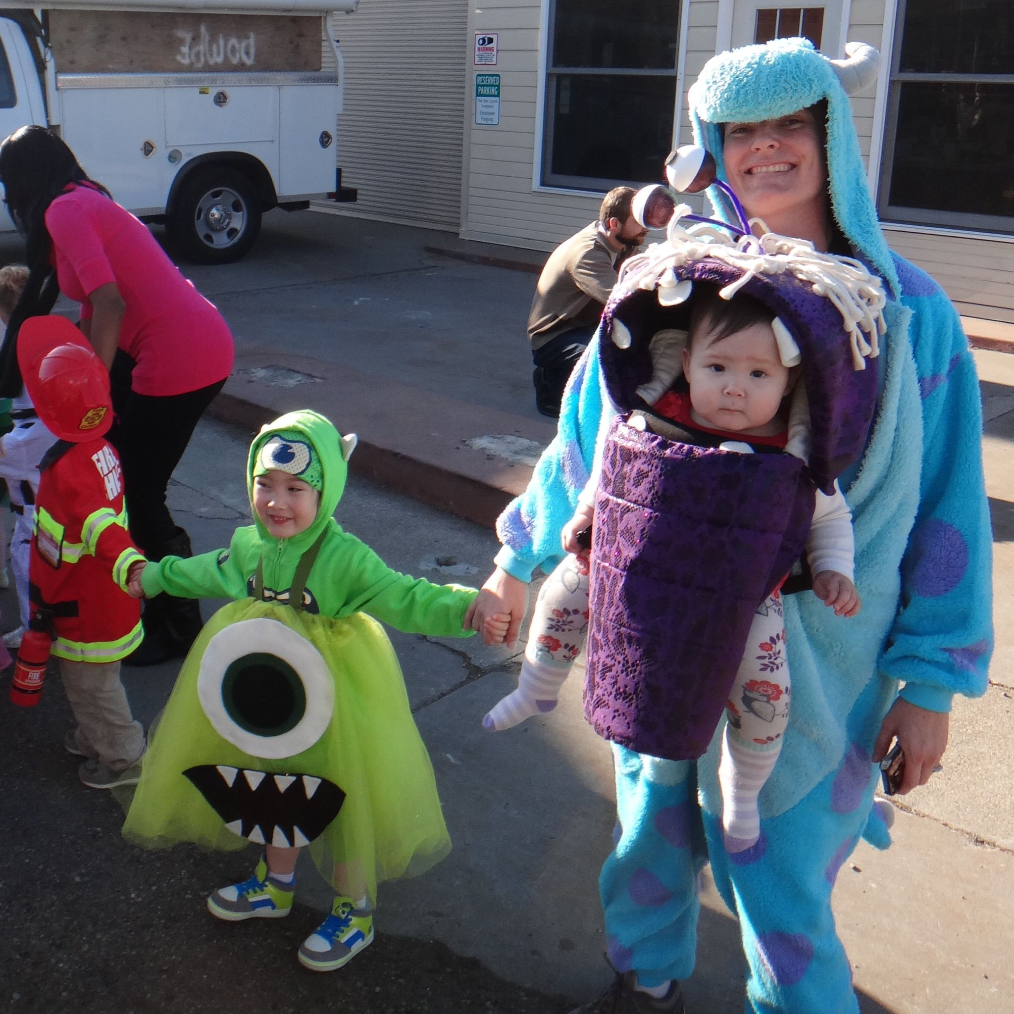 monstrous babywearing costume desiree and family as monsters from monsters inc - Monsters Inc Baby Halloween Costumes