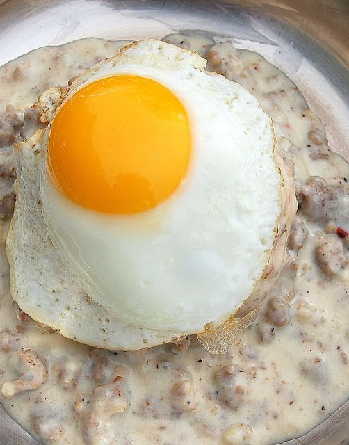 Souffle Bombay: White Sausage Gravy with Biscuits and a Fried Egg.