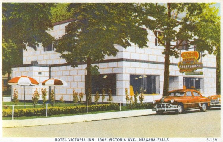 """This photo depicts the Hotel Victoria Inn in 1954. Owned by Terry and Mary Kosloff, the Inn advertised """"five minutes from the Falls and the Summer Theatre"""" which was held at NFCVI during the early 1950's.  Since 1964, this building has been the home of the Jade Garden Restaurant. Niagara Falls Public Library. Canada 150."""