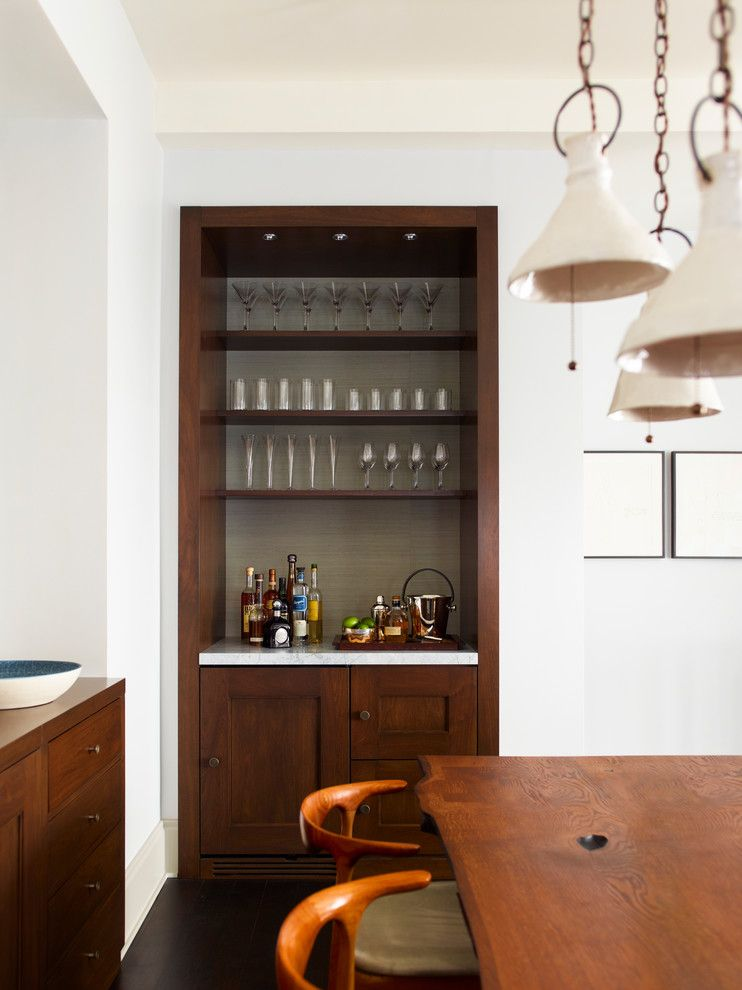 A Brown Wooden Built In Shelves With White Marble Bar Counter Top Glass Shelves On Top And Wooden Cabinet Un Small Bars For Home Bars For Home Dining Room Bar