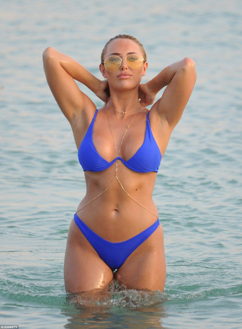 d085227e00a Amber Turner parades her surgically-enhanced cleavage in skimpy bikini