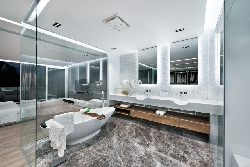 Striking Ultra Modern Master Bath And Bedroom Suite Separates The E With Wraparound Gl Wallarble Flooring Unique White Vanity Features