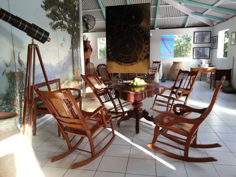 Le Kreol West Indies Presente 100 Ans De Poesie En Guadeloupe Kariculture Home Decor West Indies Rocking Chair