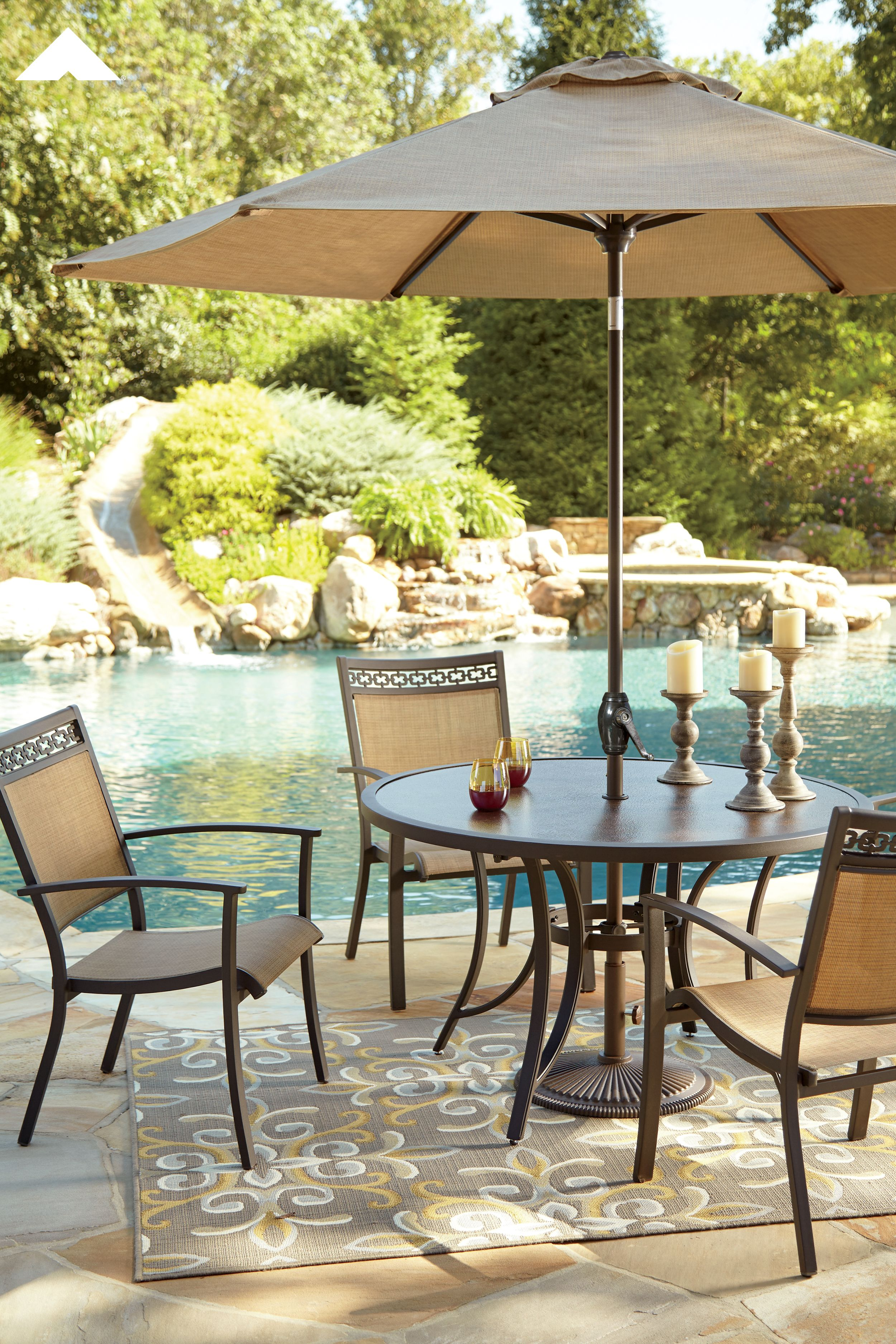 Carmadelia Tan Brown Round Dining Table with Umbrella
