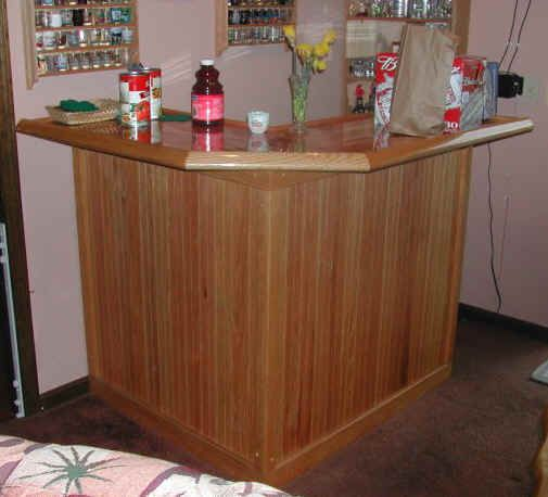 build some type of corner shaped bar... add a cork counter ...