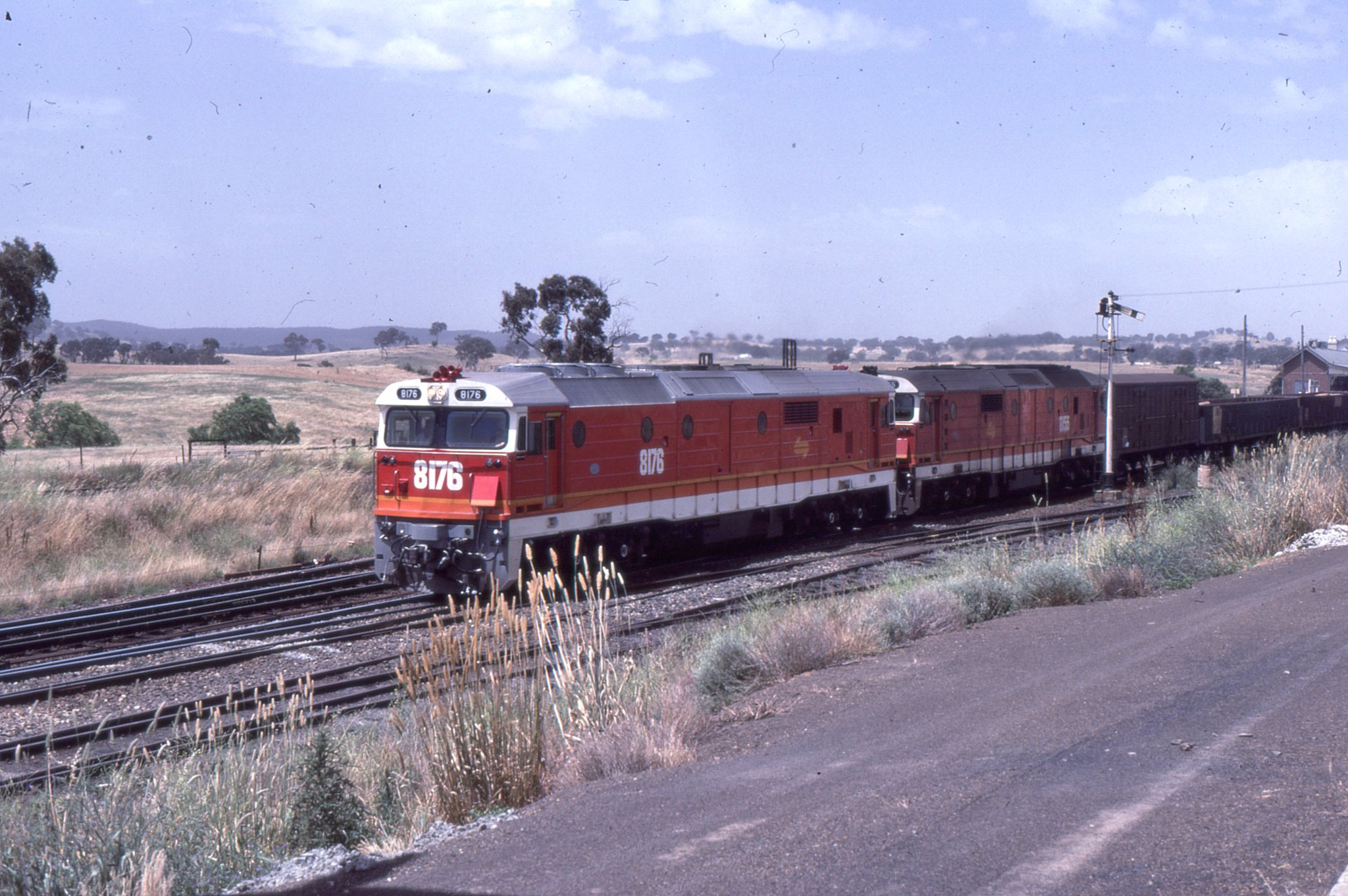 nsw sra 8176 and 8155 haul a southbound freight train through yass junction nsw 1985 train poconos railway pinterest