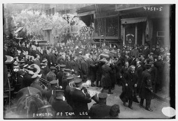 Funeral procession of Tom Lee, boss of the On Leong Tong, through Chinatown.