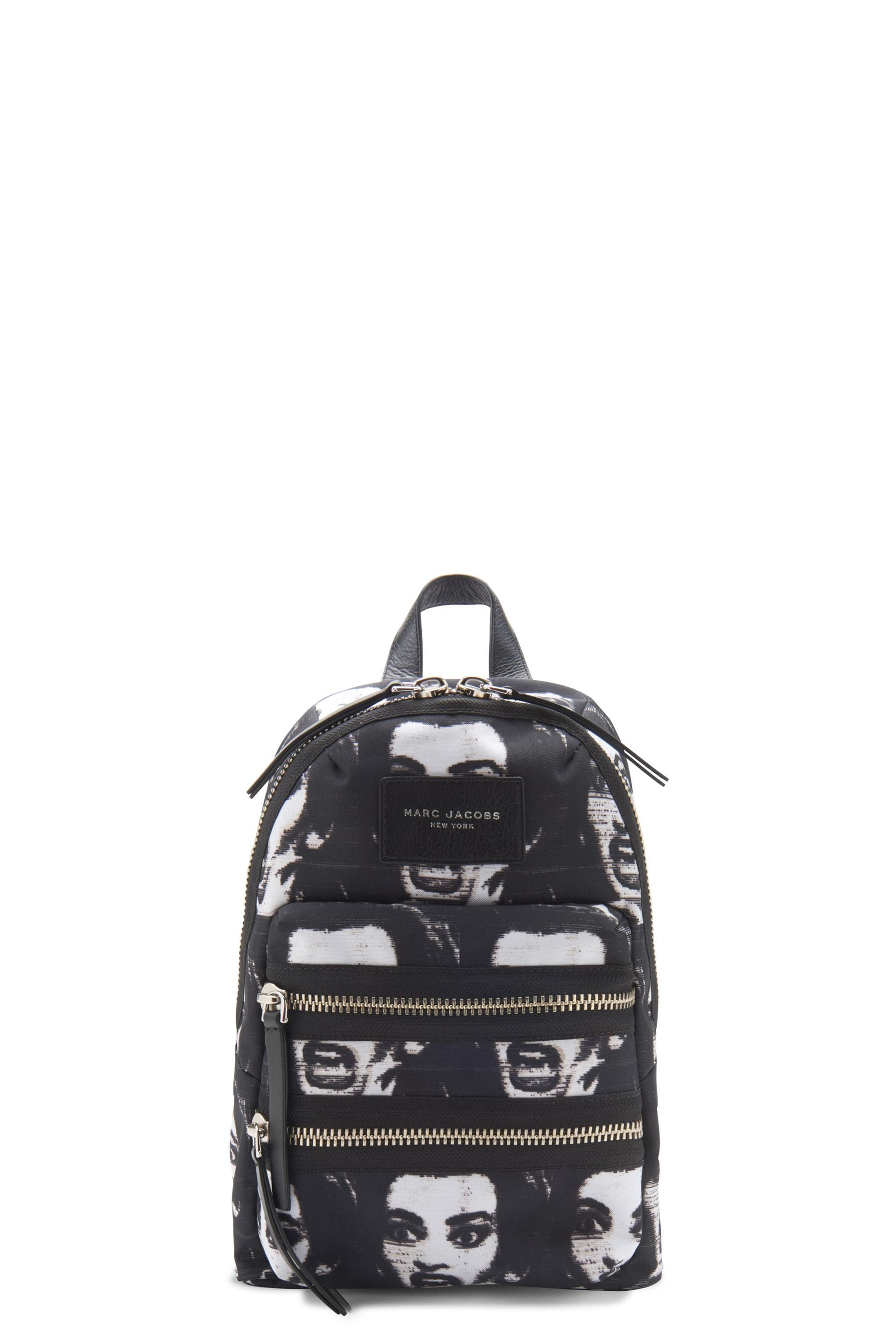 The Marc Jacobs Printed Biker Mini Backpack is made from lightweight and durable polyester and features an exclusive, allover print inspired by American cinema. The bag features a double zip around entry, two exterior zip pockets and two adjustable shoulder straps. 100% Polyester