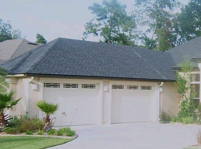 2 12 X8 Custom Insulated Steel Garage Doors Installed On A New Home In Jacksonville Fl Garage Doors Garage Door Repair Overhead Garage Door