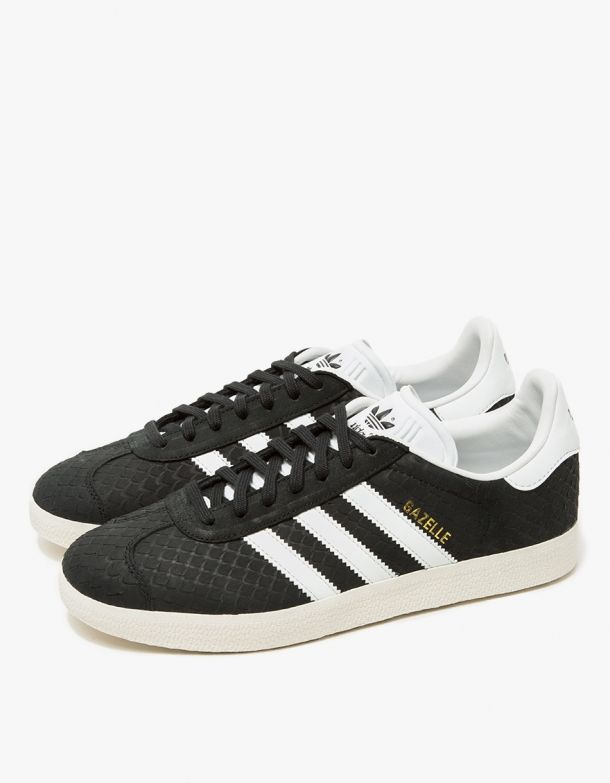 From Adidas, a classic sneaker in Black and White. Featuring a snake-patterned leather upper, flat cotton laces, padded collar, '3-Stripe' branding at side panels, 'Trefoil' logo at tongue and heel with a rubber sole.  • Sneaker in Black and White • Sn