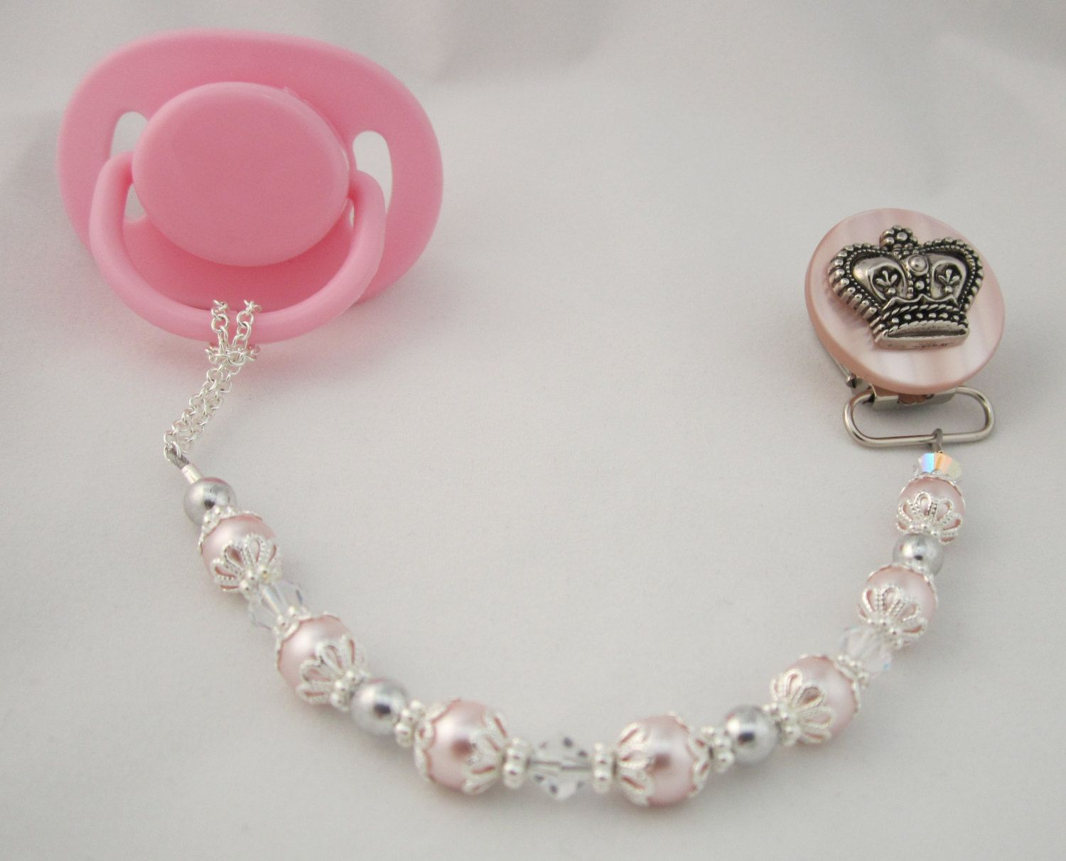 If a Girl  Pink Crown Pacifier clip with Pink Swarovsky Pearls and Crystals (CCP)  Dummy Clip, Binky Clip. $24.99, via Etsy.