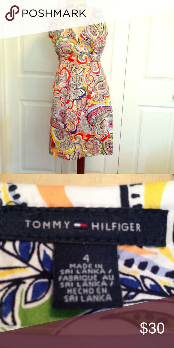 Tommy Hilfiger colorful paisley dress. Tommy Hilfiger colorful paisley dress. Size 4.  Excellent condition. Good for work or a night out. This dress is very versatile can be worn with different color shoes, jewelry or other accessories. Tommy Hilfiger Dresses Midi