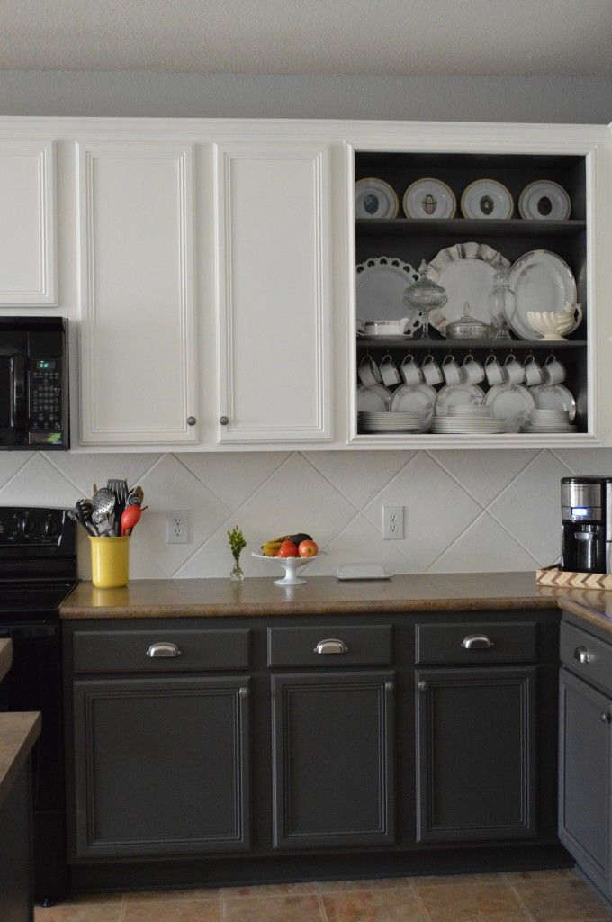 Love the dark back\u003dpainted open cabinet, and painted the tile - how