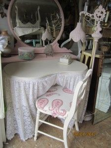 Kidney shaped vanity table and chair painted in aqua blue