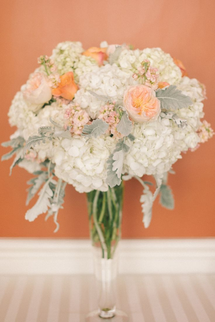 Orange traditional wedding decor  Traditional Hotel Monaco Wedding  Flowers by B Floral and Event