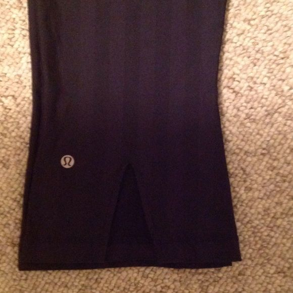 Lululemon Yoga Pants Has a very faint black on black pin striped pattern. Fits a size 8, does not display size on garment. Slit detail on back of the leg. Cropped yoga pants. Make an Offer! Great condition no piling. lululemon athletica Pants Ankle & Cropped