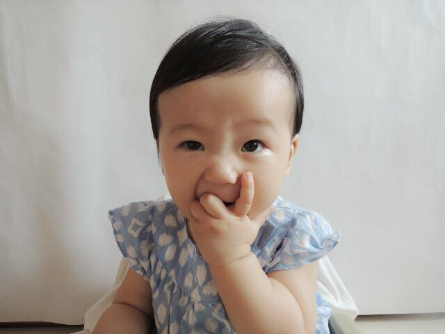 My niece, Saebyurie posing for her first passport pictures!